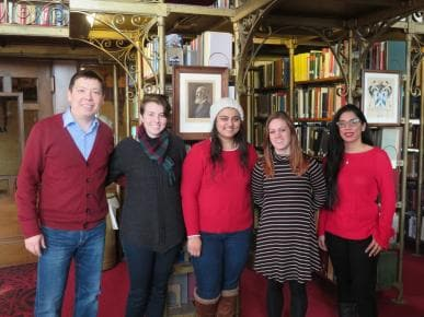 Multilingual writing tutors posing in the AD White Library