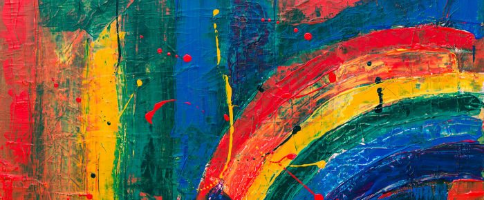 A background of abstract art, which has thick paint brushed in an arch, almost rainbow like in color and effect.