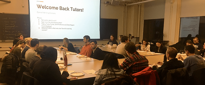 Tables of tutors attending a welcome back tutor staff meeting